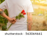 man with a rose behind his back ... | Shutterstock . vector #563064661