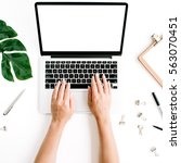 workspace with hands typing on... | Shutterstock . vector #563070451