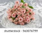 Stock photo bunch of roses pink roses on silk background 563076799