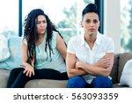 unhappy lesbian couple sitting... | Shutterstock . vector #563093359