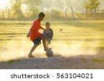 little boys playing football in ...   Shutterstock . vector #563104021
