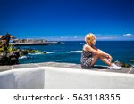 young blonde woman sitting on...   Shutterstock . vector #563118355