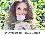 Stock photo woman with flowers 563122885