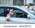 young man doing thumps up in... | Shutterstock . vector #563128711