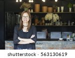 Small photo of Successful small business owner standing In Coffee Shop