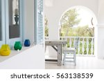 Table And Chairs On Balcony Of...