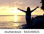 woman standing and lift hand ... | Shutterstock . vector #563140021