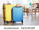 packed travel suitcases at home | Shutterstock . vector #563140189