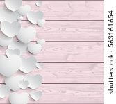 white hearts on the pink wooden ... | Shutterstock .eps vector #563161654