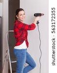 beautiful young woman using a... | Shutterstock . vector #563172355