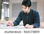 indian male student studying... | Shutterstock . vector #563173855
