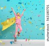 little child plays superhero.... | Shutterstock . vector #563180701