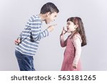 brother and sister arguing | Shutterstock . vector #563181265