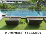 deck chairs  swimming pool in... | Shutterstock . vector #563233801