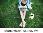 top view of woman sitting in... | Shutterstock . vector #563237491