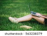 Young Woman's Legs On The Gree...
