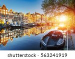 Stock photo amsterdam canal at sunset amsterdam is the capital and most populous city in netherlands 563241919
