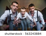 young groom with his handsome... | Shutterstock . vector #563243884