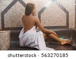 topless girl wrapped in a... | Shutterstock . vector #563270185