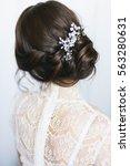 elegant brunette bride sitting... | Shutterstock . vector #563280631