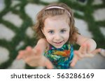 smiling girl trying to take... | Shutterstock . vector #563286169