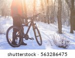 mountain biker with his bike on ... | Shutterstock . vector #563286475