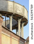 Small photo of detail of thin pillars and brick decoration of water tank in old industrial village, shot in winter at Crespi Adda, Capriate, Lombardy, Italy