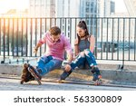 Young Couple On Rollerblades...