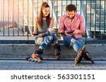 couple with cell phones. people ... | Shutterstock . vector #563301151