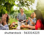 group of friends dinning on the ... | Shutterstock . vector #563314225
