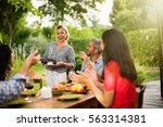group of friends dinning on the ... | Shutterstock . vector #563314381