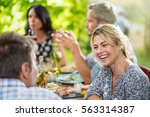 group of friends gathered... | Shutterstock . vector #563314387