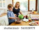 smart cute child helping mother ... | Shutterstock . vector #563328979