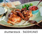 Stock photo roasted rabbit with herbs tomato sauce and glass of wine on a plate hot meat dishes 563341465