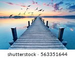 silent place  wooden jetty at... | Shutterstock . vector #563351644