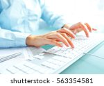 female hands or woman office... | Shutterstock . vector #563354581
