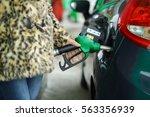woman fills petrol into her car ... | Shutterstock . vector #563356939