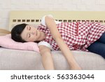 tired asian housewife | Shutterstock . vector #563363044