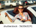young pretty woman sitting in a ... | Shutterstock . vector #563363191