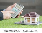 man counting payments for home  ...   Shutterstock . vector #563366821