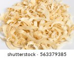 soft dried coconut chips low... | Shutterstock . vector #563379385