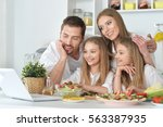 big family on the kitchen | Shutterstock . vector #563387935