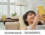 vietnamese young girl lying on... | Shutterstock . vector #563400091