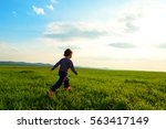 Young Child Running Through A...