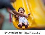parent hand holding asian kids... | Shutterstock . vector #563436169