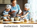 happy family in the kitchen.... | Shutterstock . vector #563440411
