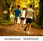 group of young runners running... | Shutterstock . vector #563443165