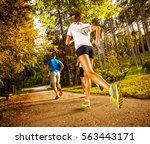 group of young runners running... | Shutterstock . vector #563443171