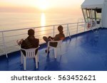 man and woman on deck of cruise ... | Shutterstock . vector #563452621