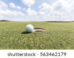 golf ball on lip of cup. golf... | Shutterstock . vector #563462179